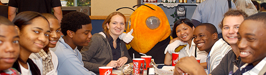 Students enjoying lunch with Buzz